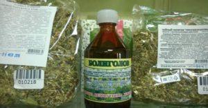 сухая трава, флакон с лекарством
